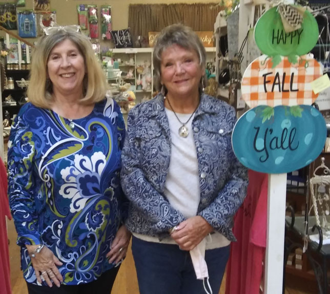 MARKETPLACE ON MAIN co-owners Pattie Carter, left, and Cathy Noel are selling the antique and gift shop they've owned on North Main Street for more than 11 years. They say the new owners will keep the shop open – and keep the name. (Photo by John McGary)
