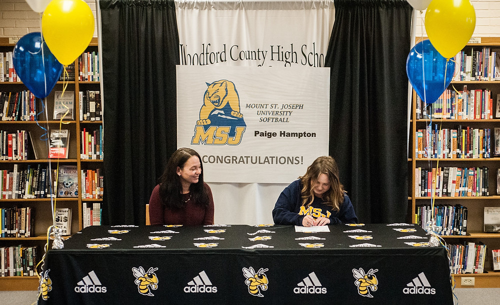 PAIGE HAMPTON, right, signed her letter of intent to play softball at Mount St. Joseph University on Tuesday, Jan. 9. (Photo by Bill Caine)