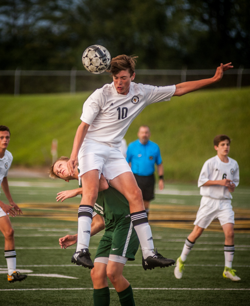 HUNTER PENN delivers a header in the first half against Western Hills. (Photo by Bill Caine)