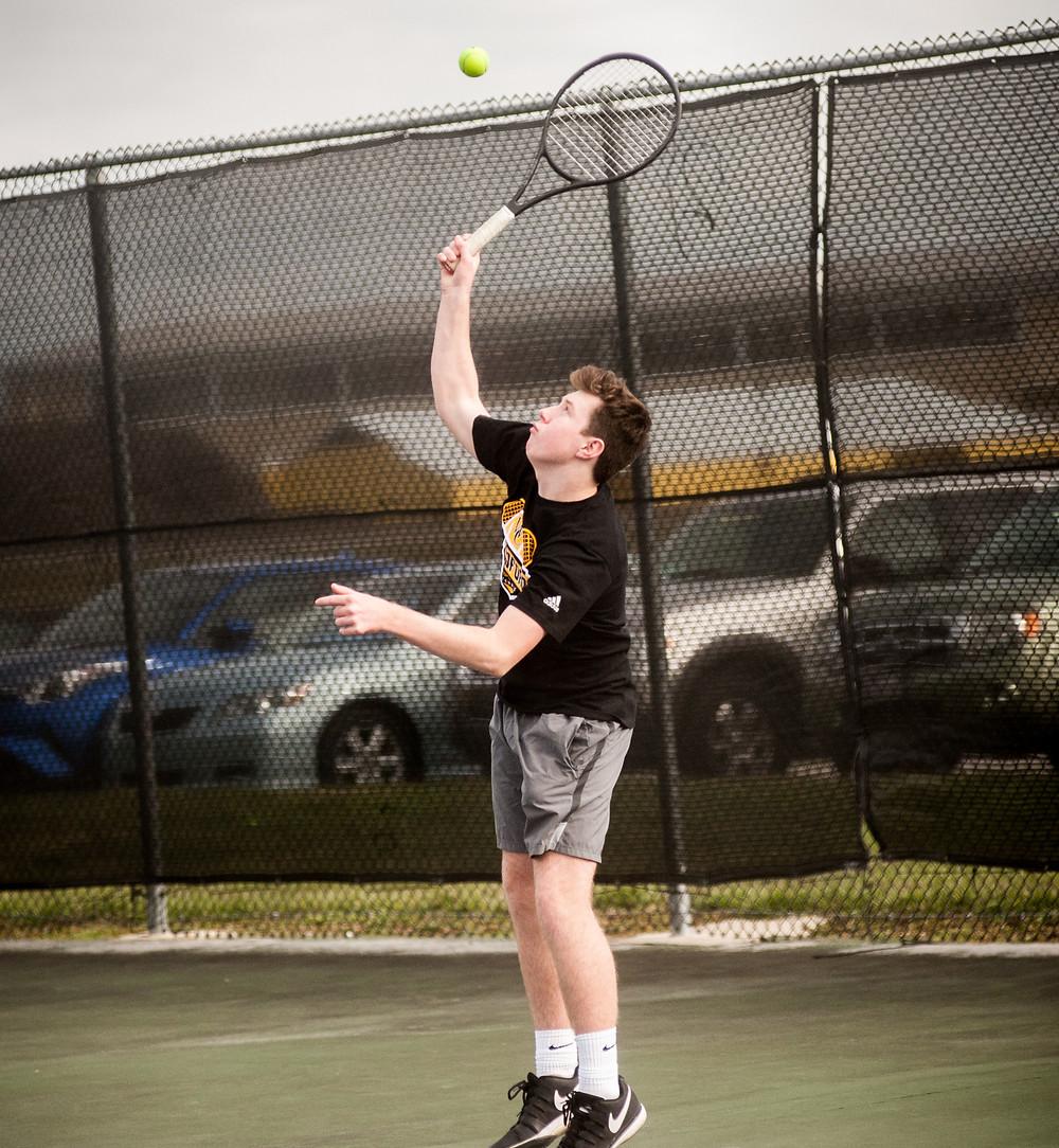 WCHS JUNIOR BEN ISON, pictured earlier this season, won his doubles match with teammate Zachary Stiefel against Lexington Catholic on Tuesday, March 27 at Shillito Park in Lexington. (File photo by Bill Caine)