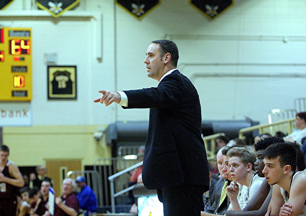 SCOTT HUNDLEY, head coach of the Woodford County High School boys' basketball team, announced his resignation on Monday, March 7. Hundley leaves the team after six seasons with a 107-82 record, three district titles, six regional tournament appearances, and three regional tournament wins. (Photo by Rick Capone)
