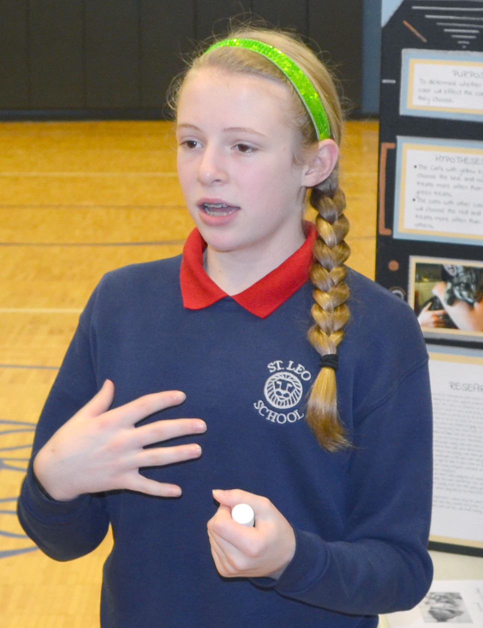 "RAYLEE CARRICO, a seventh-grader at St. Leo School, concluded that fourth- and fifth-graders preferred natural, not artificial, flavoring in bottle water, based on blind-taste tests in her science project, ""Can You Tell a Difference?"" (Photo by Bob Vlach)"