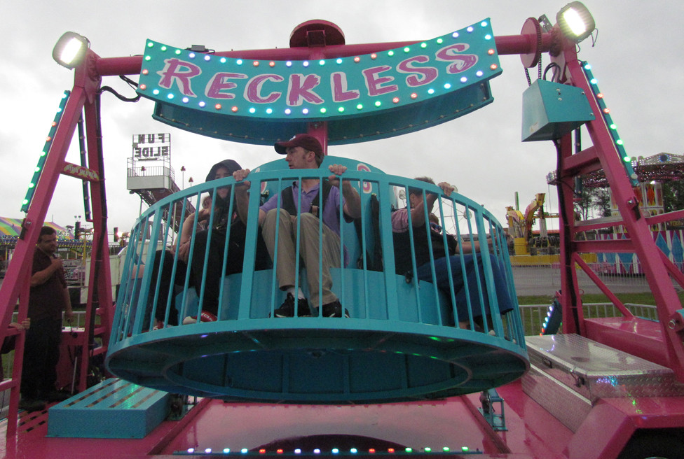 PETER GALLION of the Stewart Home & School in Frankfort was one of about 60 children and adults with special needs who had the Woodford County Fair all to themselves for two hours last week. (Photo by John McGary)