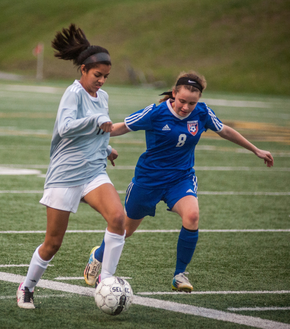JAYLYNN MURILLO fights to keep possession of the ball in the district opener against Frankfort on Wednesday, Oct. 11. (Photo by Bill Caine)