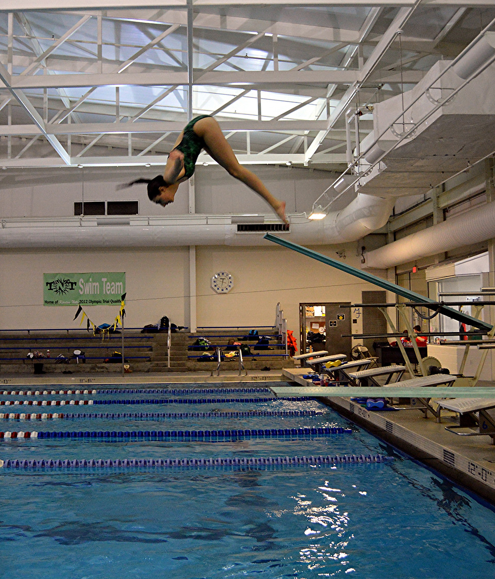 JACQUI KOWALKE, a senior diver for the Woodford County High School diving team, finished first in the one-meter diving competition at the Region 6 Swimming and Diving Competition, which was held at the Falling Spring swimming and diving complex, Friday and Saturday, Feb. 12 and 13. In the process, Kowalke set a new Region 6 points record as well. (Photo submitted)