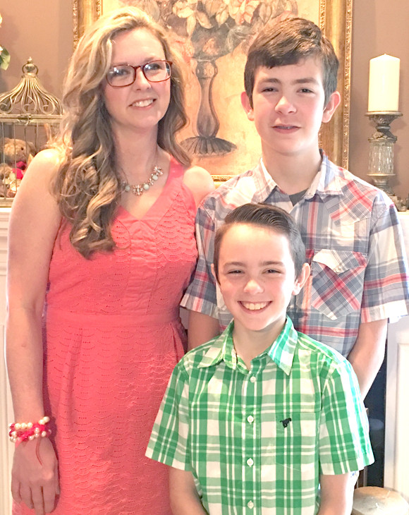 TRACEY FRANCIS has been hired as the new director of special education for Woodford County Public Schools. The Leslie County native, pictured with her sons, Elijah, right, and Isaiah, will begin her duties here on July 10. (Photo submitted)