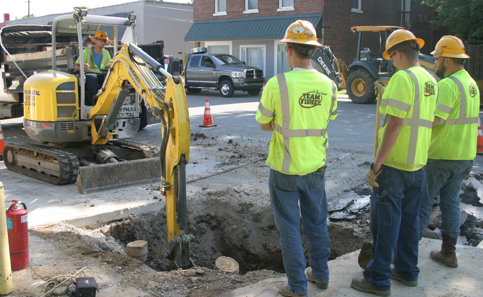COLUMBIA GAS's line replacement program continued on South Locust Street Monday. According to Versailles Public Works Director Bart Miller, similar work on Morgan Street should be finished by Thursday, June 15. (Photo by John McGary)