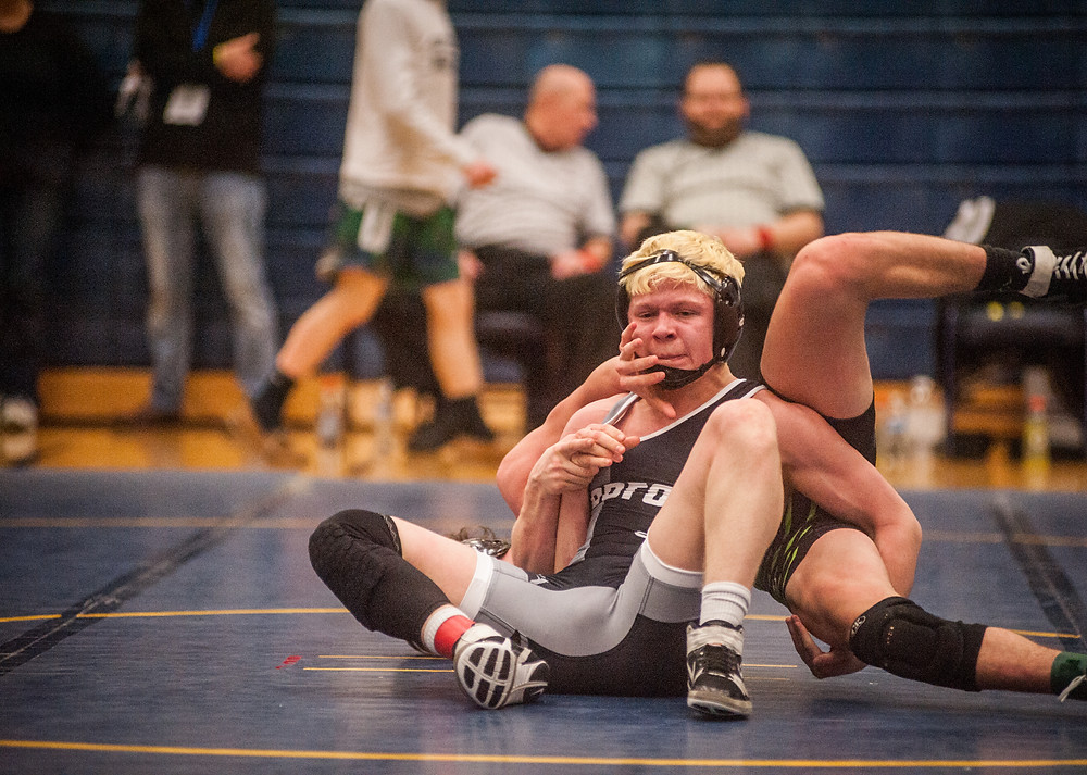 WCHS SOPHOMORE CHASE YOST applies pressure to Oldham High School's Jacob Anderson in the regional semifinal match. Yost placed first in the 138-pound weght class. (Photo by Bill Caine)
