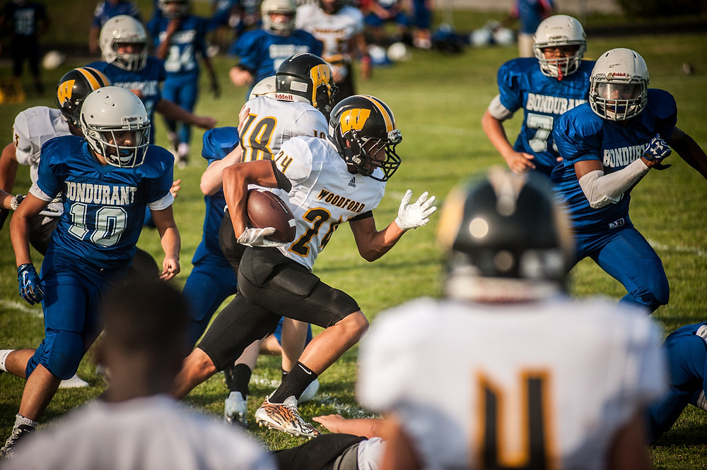 TYLER MORRIS breaks away for a first half run during the Woodford County Middle School's loss to Bondurant on Aug. 10. (Photo by Bill Caine)