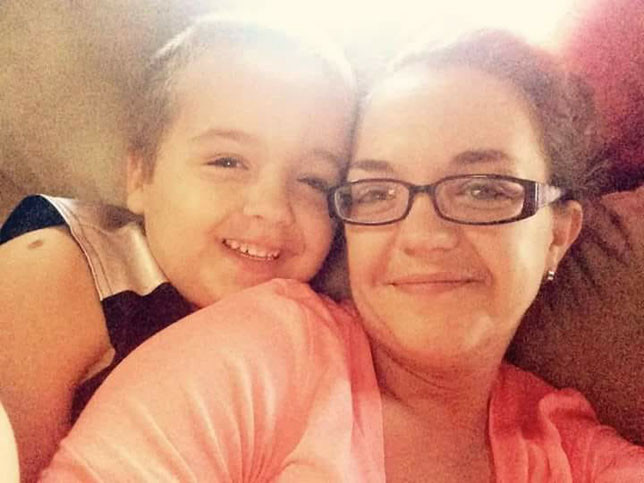 """LOGAN TIPTON is pictured with his mom, Heather Tipton. She remembers coming home from work and Logan giving her a hug and telling her, """"I love you mommy. How was your day?"""" (Photo submitted)"""