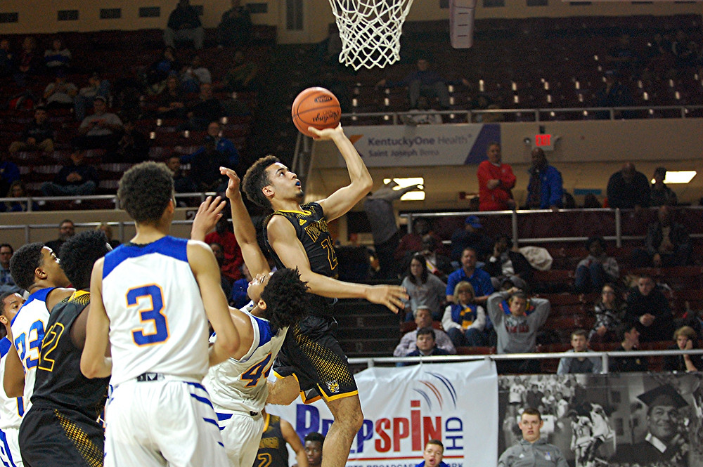 KEAGAN STROMBERG goes for a layup during the Woodford County High School boys' basketball opening-round game against Henry Clay in the 11th Region Basketball Tournament at Eastern Kentucky University's Paul S. McBrayer Arena on Thursday, March 3. Stromberg led the team with 10 points in the game, which Henry Clay won 72-41. (Photo by Rick Capone)