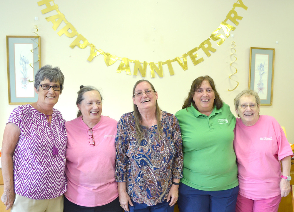 """AILENE TRUE joined her four sisters during a celebration of her 50 years at Taylor Manor Nursing Home on Thursday, Oct. 5. """"You have to like the job you're doing. And I do,"""" says True. From left are Christine Smith, Bonnie Washburn, True, Connie Sams and Sue Harris. All five sisters have worked or still work at Taylor Manor. (Photo by Bob Vlach)"""