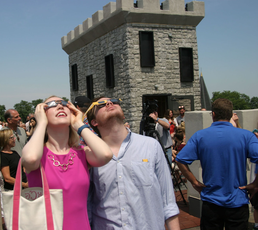 UK STUDENTS Kate Cox and Tyler Mertens were among the hundreds who took in the eclipse Tuesday at CastlePost, most of whom watched it from the roof of the castle. (Photo by John McGary)