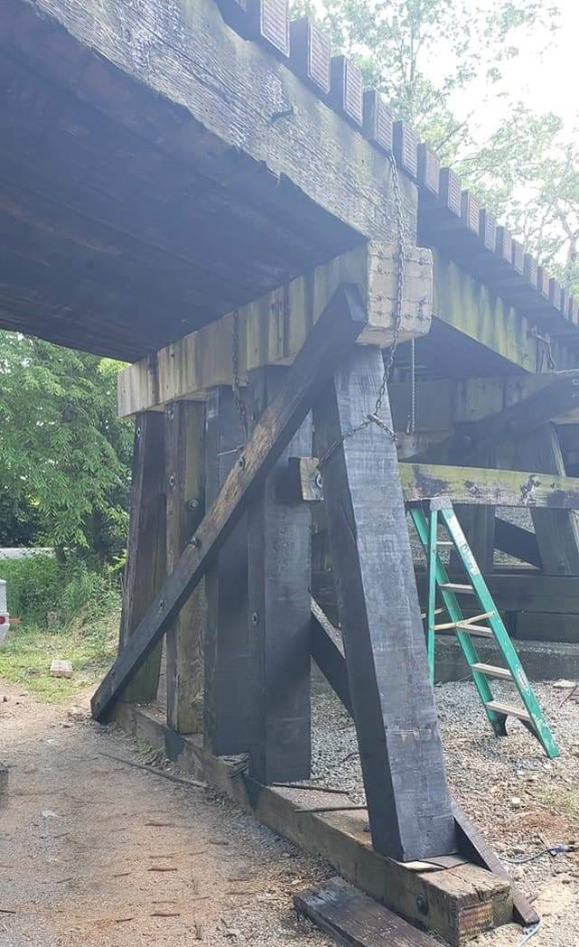 THE TRAIN TRESTLE on Milner Road, damaged when struck May 22 by a vehicle driven by a person later charged with DUI, has been repaired and the Bluegrass Railroad Museum is set to resume its round-trips to the Kentucky River. (Photo by Chris Frederick)