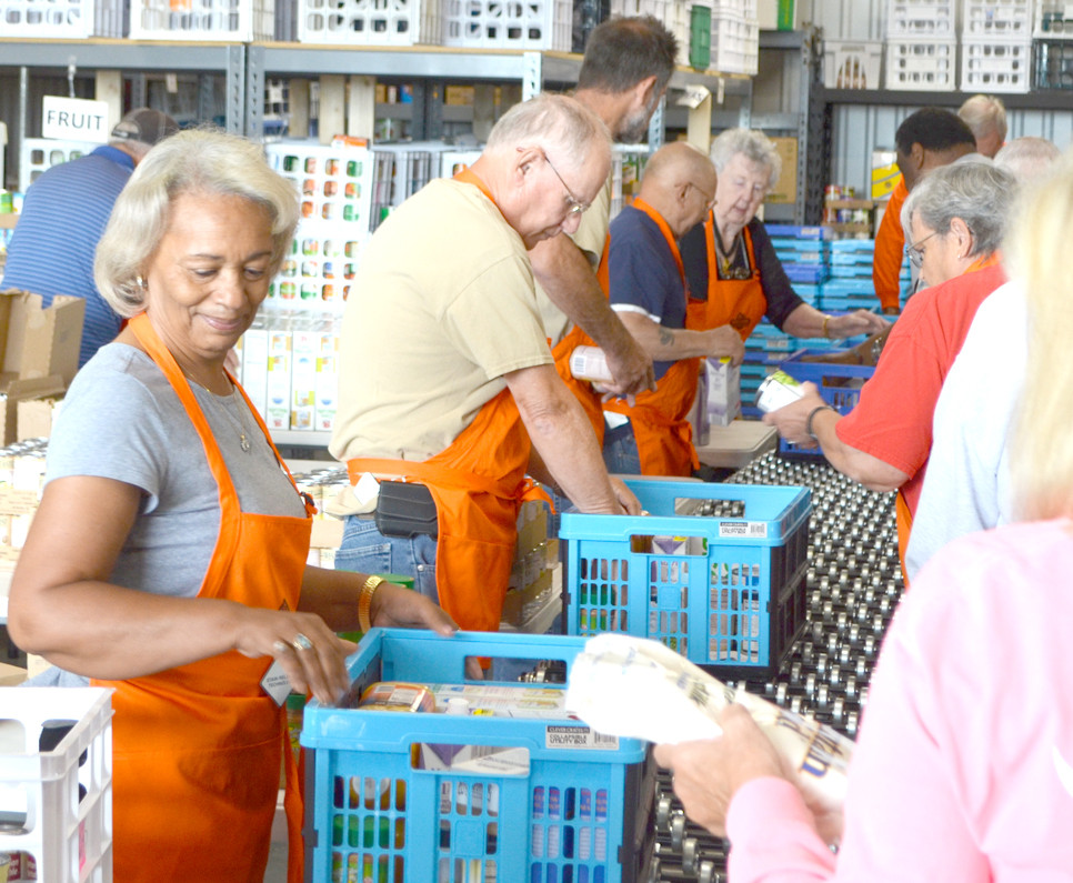 SENIORS LIVING ON FIXED INCOMES will receive baskets of commodity food items because of the efforts of volunteers with the Food Pantry for Woodford County. (Photo by Bob Vlach)