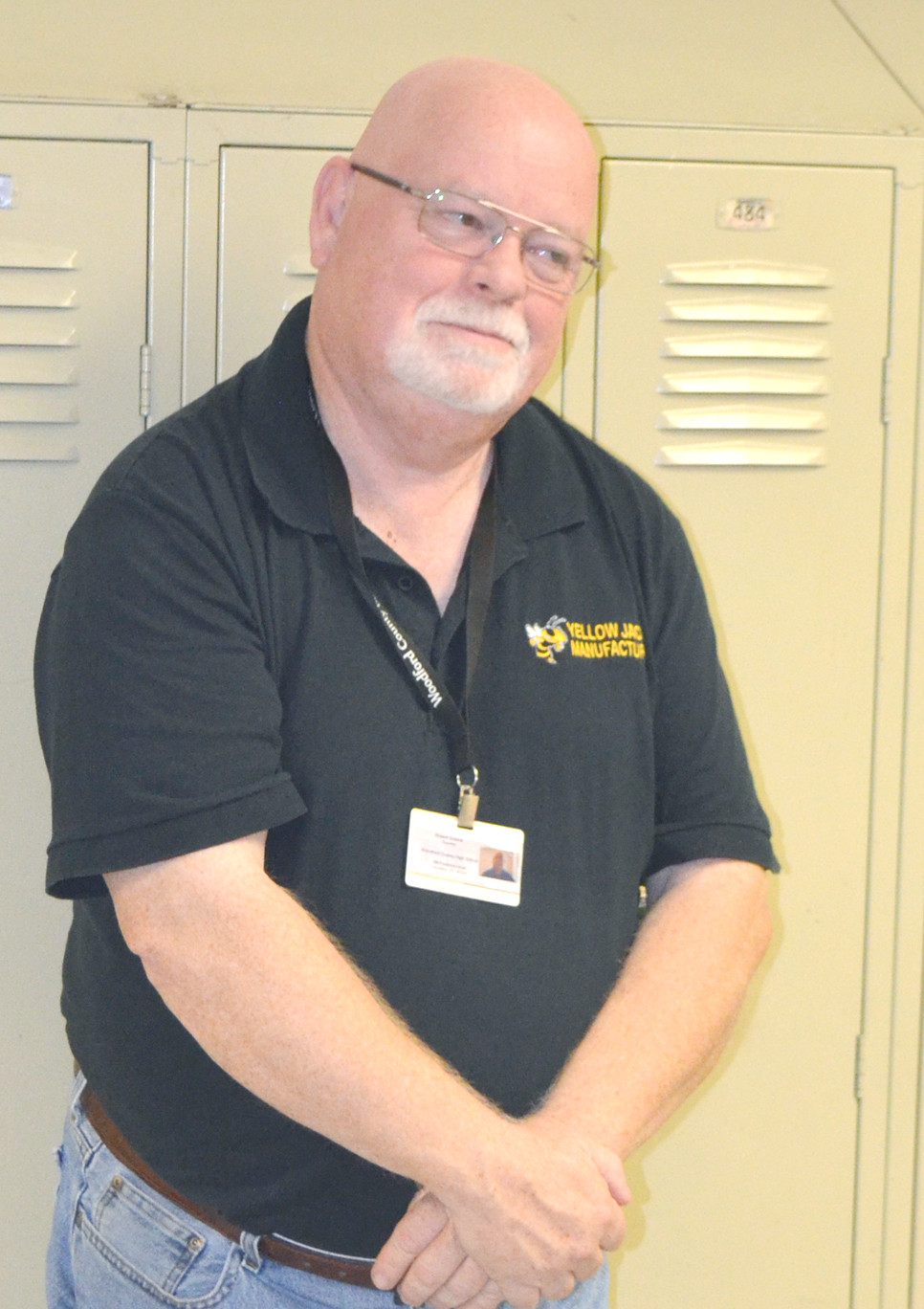"ROBERT GREENE chatted with teachers and students while monitoring the hallway outside of his classroom at Woodford County High School. ""There's just a great community feeling here,"" says Greene, 2018-19 Teacher of the Year at WCHS. (Photo by Bob Vlach)"