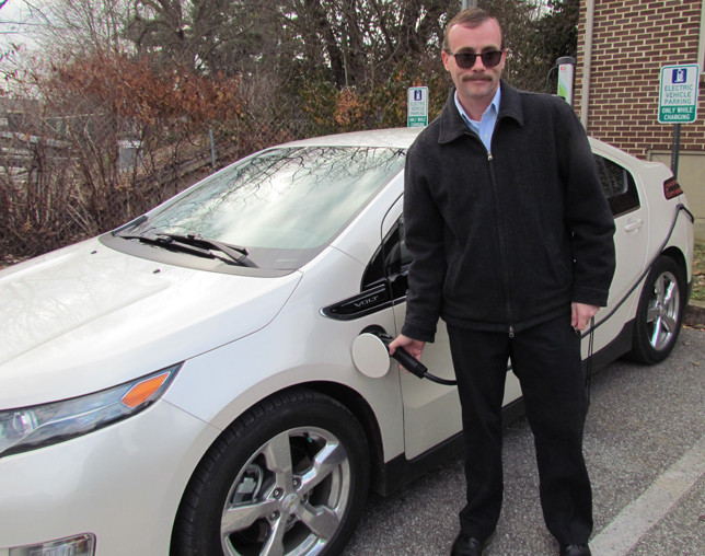 ELLIOTT CAMPBELL was the first private citizen to use the new EV charging station behind Midway City Hall, which set aside two parking spaces for it. (Photo by John McGary)