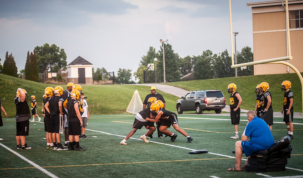 THE WOODFORD COUNTY HIGH SCHOOL football team runs drills on the practice field. (Photo by Bill Caine)