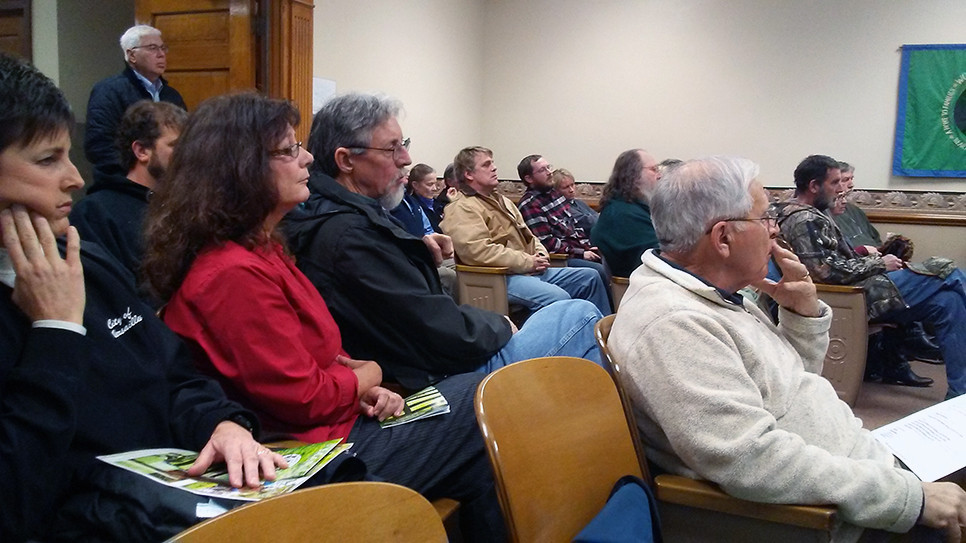 A PUBLIC HEARING on the discontinuance of Shryocks Ferry Road Dec. 12 attracted a near-full house to Woodford Fiscal Court and led magistrates to postpone a decision on the matter. (John McGary photo - audience at meeting)
