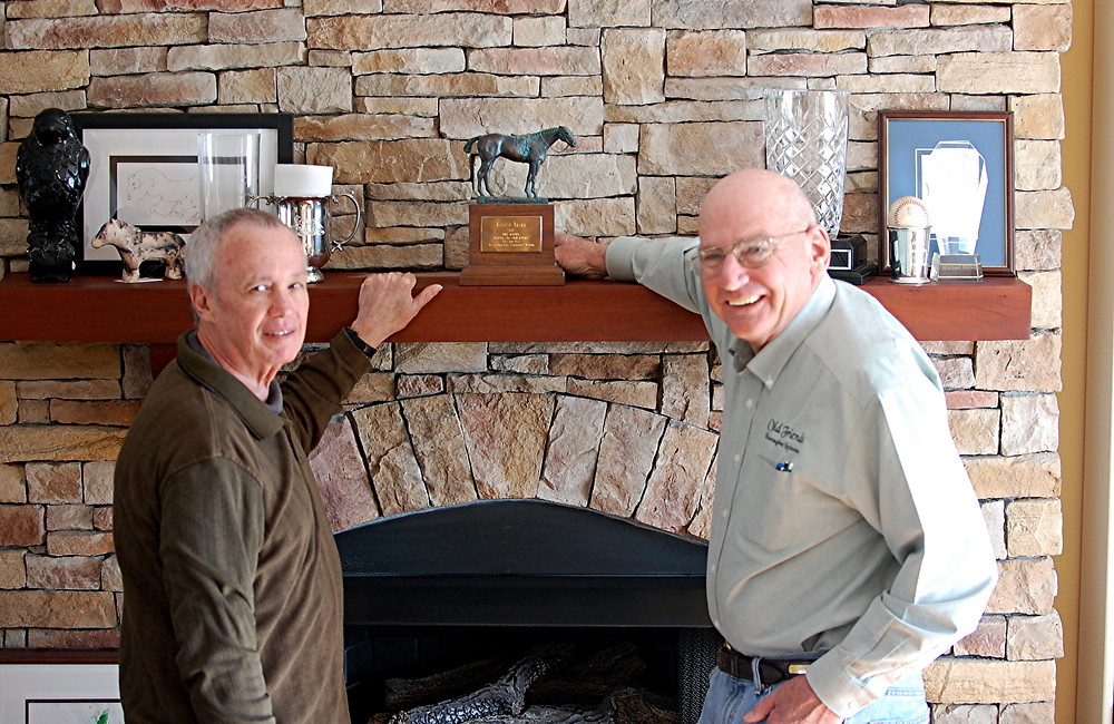 BILL MOONEY, left, stands with Old Friends' founder and friend Michael Blowen, in front of the Eclipse award he won in 2007 writing about the death of one of the farm's horses, Precisionist. He gave the Eclipse award statue to Old Friends. (File photo by Rick Capone)