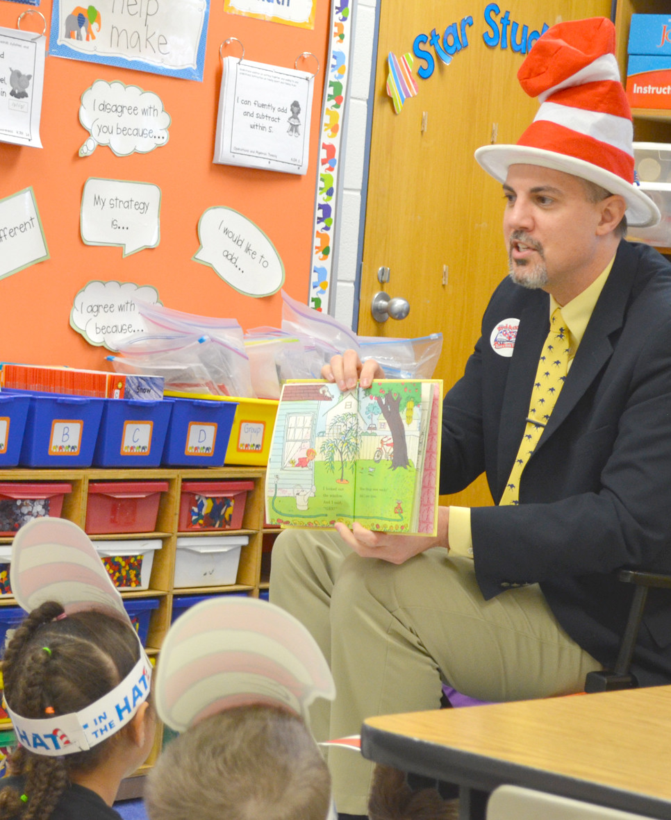 GARET WELLS read Wacky Wednesday by Dr. Seuss during Read Across America Day at Southside Elementary School last March 2. Woodford County Public Schools' director of staff/student services has been hired as assistant superintendent for Franklin County Public Schools. (File photo by Bob Vlach)