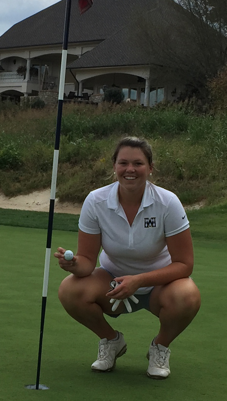 JANE WATTS poses with her ball after making a hole-in-one. (Photo submitted)