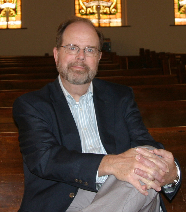 "KEITH BENZE is the new pastor of Versailles Presbyterian Church, which has been at its present location at 130 N. Main Street since 1878. The former FDA regulator jokes, ""What I tell everybody is that I'm still in regulatory compliance - it's just a different set of regulations."" (Photo by John McGary)"