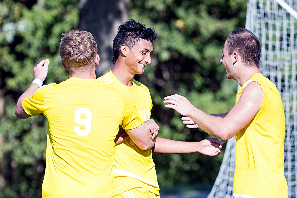 CARLOS PINTO, middle, a freshman on the Midway University men's soccer team, recorded his fifth goal of the season when he netted the game winner in the Eagles' 1-0 victory over Asbury on Saturday, Oct. 15. (Photo courtesy of Midway Univ. Athletics)