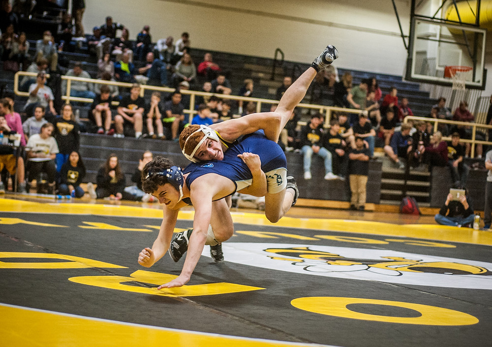 C.J. CARDWELL drives his opponent into the mat during the Woodford Duals on Wednesday, Nov. 29 at Woodford County High School. (Photo by Bill Caine)