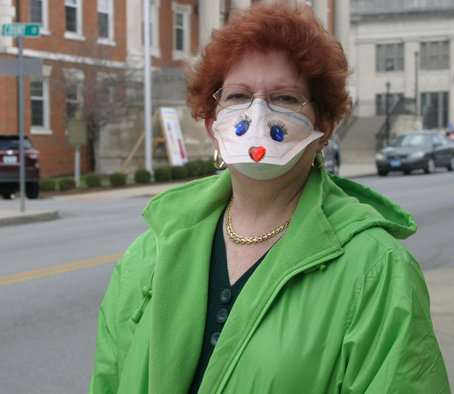 "PAT SUTHERLAND must wear a surgical-type mask when she leaves her home, but said it's a small price to pay for the heart she received nearly a year ago. Her health and outlook have improved, she said: ""I'm more positive."" (Photo by John McGary)"