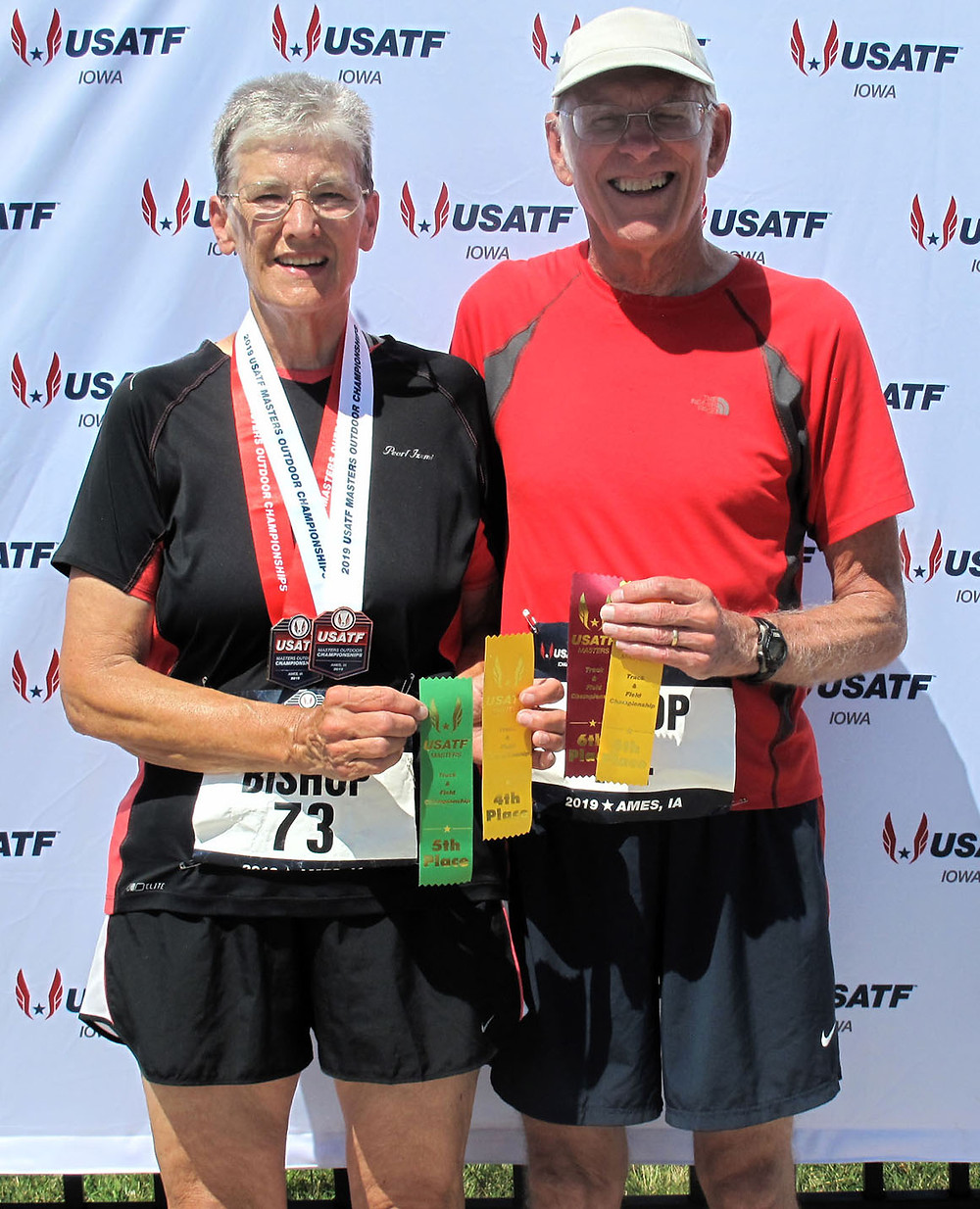 CATHARINE AND CHARLES BISHOP, both of Versailles, brought plenty of ribbons home from the USATF Masters Outdoor Championships in Ames, Iowa. Catharine also earned a pair of medals— a silver in the 200-meter dash and a bronze in the triple jump. (Photo submitted)