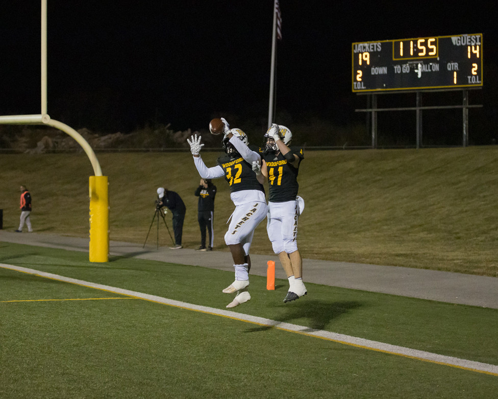 JUMPING FOR JOY: WCHS Yellow Jackets JD Alexander, left, and Jackson Geilear celebrated after a touchdown reception by Alexander during last Friday's home win over Collins High School. (Photo by Marshall Imagery)