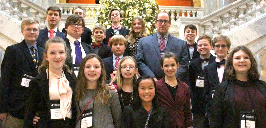 WOODFORD COUNTY MIDDLE SCHOOL sent a delegation of 16 students to a Kentucky Youth Assembly conference in Louisville and Frankfort recently. From left are, front, Elisabeth Komprs, Eliza Beach, Alex Decker, Anamei Walli, Emelia Sprinkle and Willa Michel; middle, David Clark, Bryan Birch, Aidan Lynn, Josh Haury, teacher Geoff Sprinkle, Nate Wells, Will Dowdell and Garrett Cheek; back, teacher Kyle Murphy, Ian Carr, Lucas Jones and Meghan Denton. (Photo submitted)