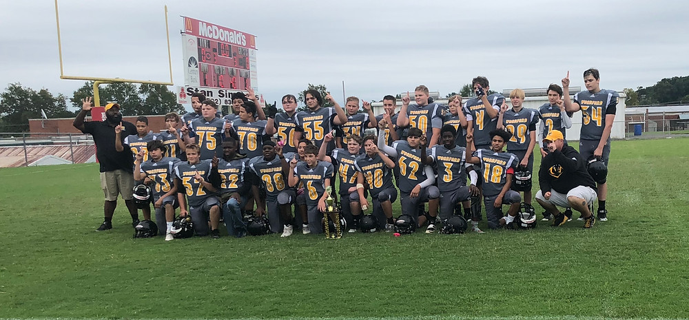 THE WCMS EIGHTH-GRADE FOOTBALL TEAM won the Seth Carnahan Memorial Bowl Game over Anderson County Sept. 22. (Photo by Marla Carroll)