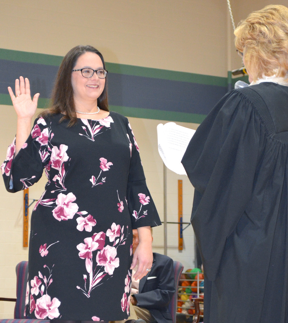 THE OATH OF OFFICE was administered to new Woodford County Board of Education member Dani Bradley, left, by District Judge Mary Jane Phelps at Southside Elementary School Jan. 4. Allison Richardson, also elected in November to serve on the school board (District 2), had a conflict and was unable to participate in last Friday's swearing-in ceremony, according to school officials. (Photo by Bob Vlach)