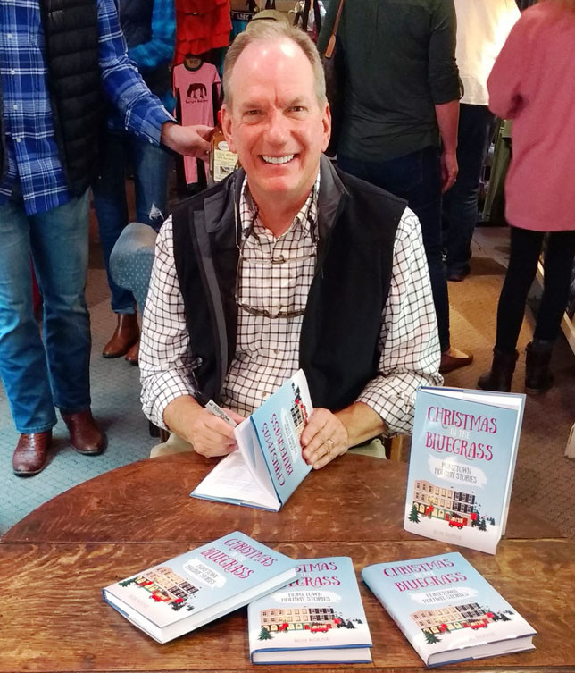 """BOB ROUSE held a signing for his new book, """"Christmas in the Bluegrass: Hometown Holiday Stories"""" at the Historic Midway Museum Store on Nov. 4. The book features 10 Christmas tales, all of which take place in Rouse's hometown of Midway. (Photo by Bill Penn)"""