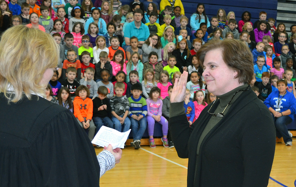 DEBBIE EDELEN, who was elected to a third four-year term on the Woodford County Board of Education in November, took the oath of office at Huntertown Elementary School last Friday, Jan. 13. Woodford District Judge Mary Jane Phelps administered the oath. (Photo by Bob Vlach)