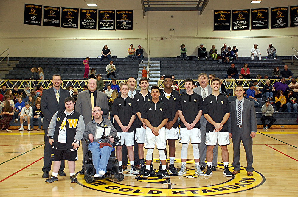 SENIOR CELEBRATION. The Woodford County High School boys' basketball team celebrated senior night in The Hive in front of family, friends and teammates prior to its game against South Oldham on Friday, Feb. 19. The seniors honored, along with their coaches, were, front row, from left, Ryan Wilson (assistant coach), Matthew Heigle, Derrick Robinson (assistant coach), Nick Gibson, Tucker Sly, Scott Hundley (head coach), Brice Hewett, Tre Winkfield, Wesley Smith, Jacob Roberts, Ted Hundley (assistant coach), Johnathan Colley, and Nick Schuerman (assistant coach). (Photo by Rick Capone)