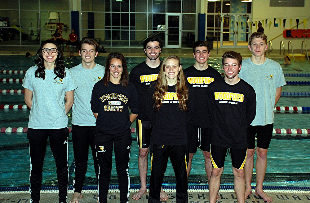 SENIOR CELEBRATION. On Wednesday, Jan. 27, at the Falling Springs swimming and diving complex, the Woodford County High School swimming and diving team honored its seniors prior to that evening's meet. The seniors honored were, from left, diver Jacqui Kowalke, and swimmers Nathaniel Eller, Callie Hicks, Luke McEachin, Megan Robertson, Jeff Bonsi, Justin O'Nan and Austin Call. Not pictured is Alberto Zambrano. Senior night was originally scheduled to be held on Jan. 20, but had been postponed due to the weather. (Photo by Rick Capone)