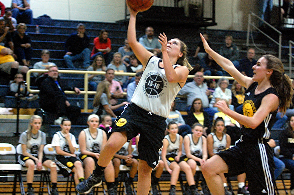 SCENES FROM the WCHS girls' basketball scrimmage during Jacket Madness on Friday, Nov.  18 in The Hive. Abbey Peterson goes for a layup during the scrimmage. (Photo by Rick Capone)