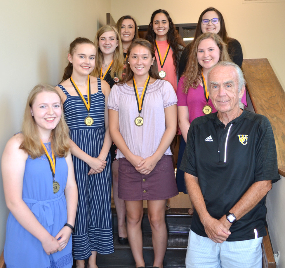 GOVERNOR'S SCHOLARS PROGRAM participants from Woodford County High School were, clockwise from left to right, Jensen McMurry, Bella Wolfe, Erin Lawson, Allison Miller, Stanislava Spasova, Emily Brookfield, Alexis Jetton and Maddie Gatewood, with Ambrose Wilson IV, chair of the Woodford County Board of Education. (Photo by Bob Vlach)