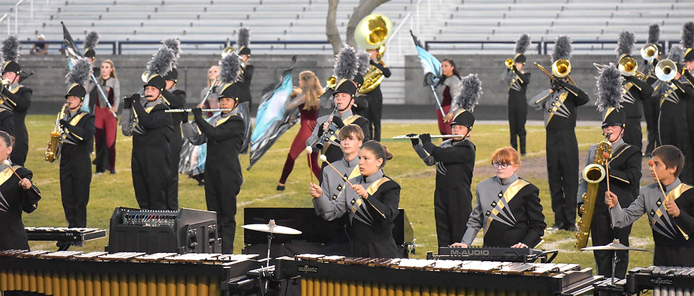 "WCHS MARCHING BAND students earned a distinguished rating at the Louisville Male Classic on Saturday, Oct. 14. ""We don't really have a weakness. Our brass (section is) strong. Our woodwinds are strong. Percussion is strong. (Color) guard is strong,"" said band Director Michael Collins. (Angela Young Photography)"
