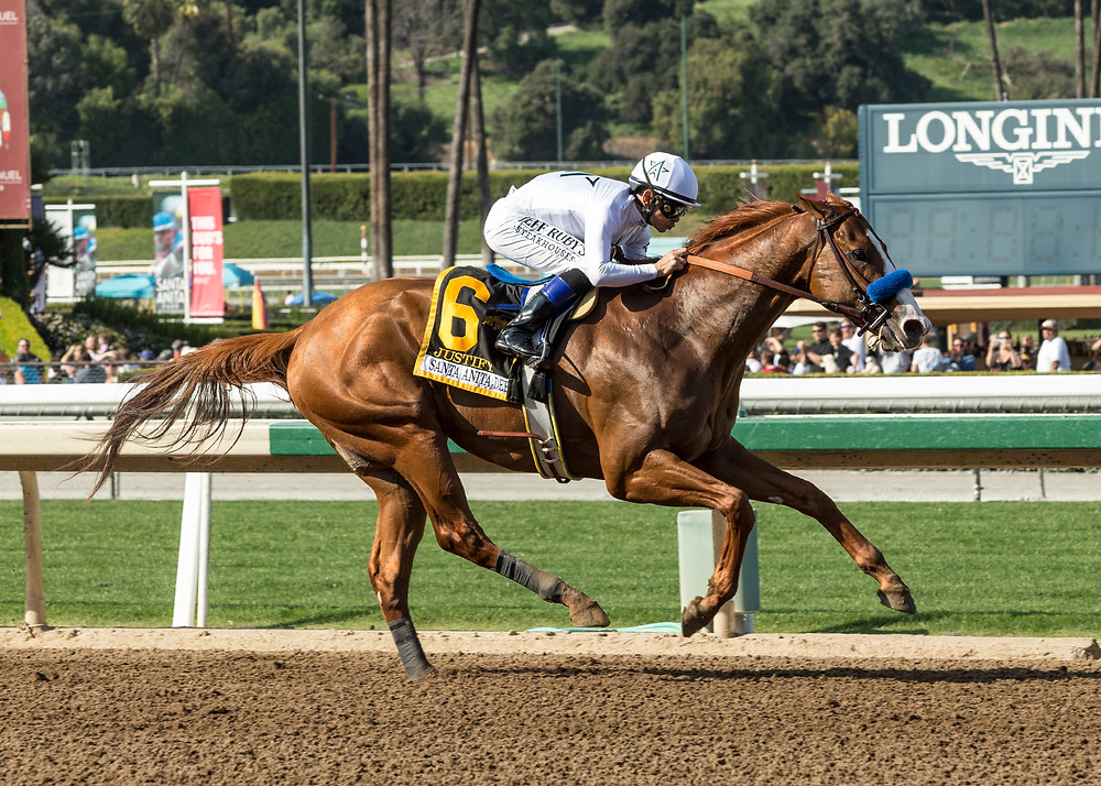 TRIPLE CROWN WINNER JUSTIFY, pictured earlier this season winning the Santa Anita Derby, has retired after uncertainty about his health. He was undefeated in his career. (Photo courtesy of Benoit Photo)
