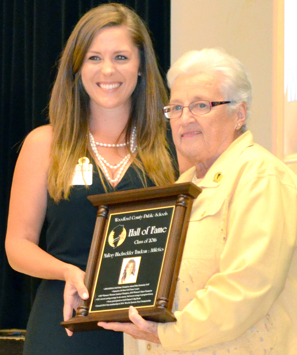 MALLORY BLACKWELDER TRUDEAU accepted her WCPS Hall of Fame plaque from Sharon Tippett, right, co-chair of the hall of fame committee. (Photo by Bob Vlach)