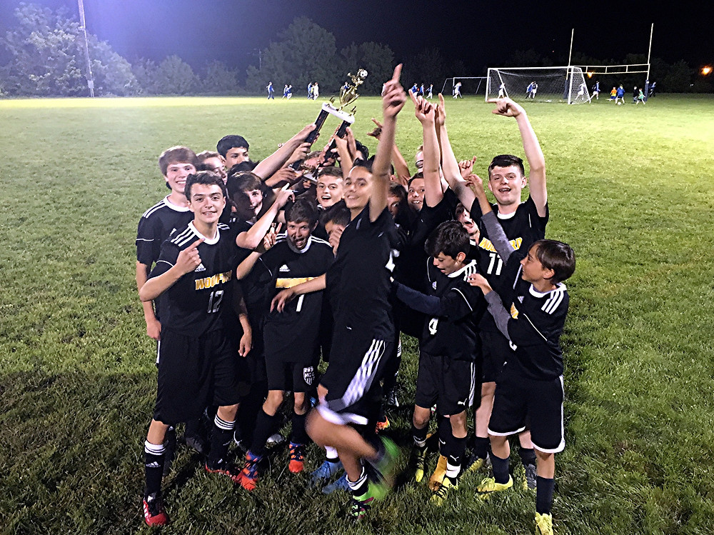 CHAMPIONSHIP CELEBRATION. The Woodford County Middle School boys' soccer team celebrates its 4-3 overtime win against No. 2-seed McNabb Middle School in the Bluegrass Conference Tournament championship game, which was held at Grant County Middle School on May 8. Members of the 2017 team are: Henry Albo, Cai Coburn, Owen Damm, Caleb Evans, Micah Evans, Brandon Figueroa, Fabian Garcia, Connor Gililland, Gael Gonzalez, Jonah Hall, Andy Johnson, Chase Jones, Jonathan Leon, Isaish Lester, Kyle Miller, Edgar Moreno, Tyler Moskovitz, Jack Shea, Jake Stewart, Alex Valdivia and Graham Washington. (Photo submitted)
