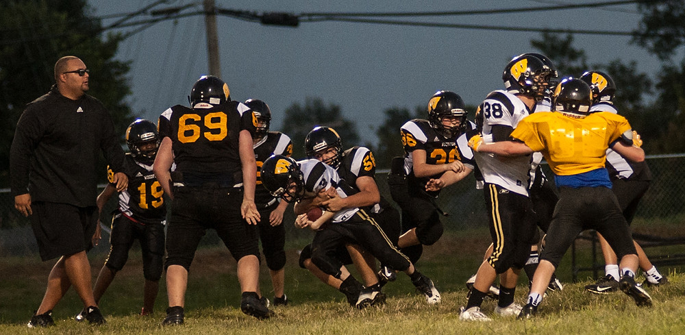 DAKOTA HOBBS makes a tackle during Woodford County Middle School football practice July 25. (Photo by Bill Caine)