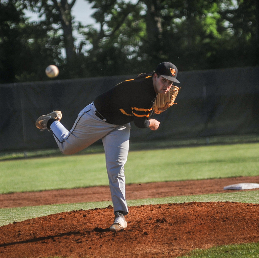 WCHS SENIOR HUNTER HILBERT throws the first pitch of the 11th Region semifinal. The Jackets lost the game to Madison Central 4-2 June 2.  Hilbert allowed two earned runs in the game. (Photo by Bill Caine)