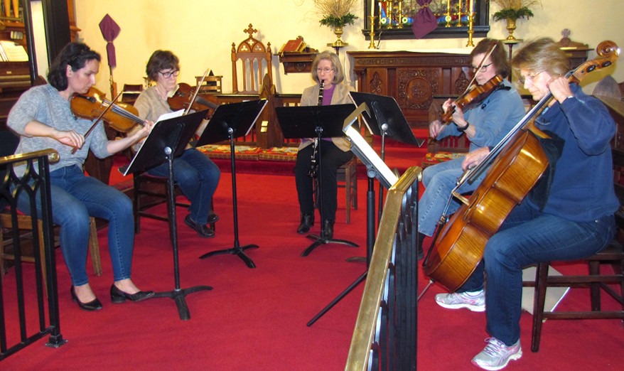 THE ST. JOHN'S PLAYERS will perform a Free Concert of Chamber Music to benefit a free literacy program for elementary school students on Sunday, March 17, at 3 p.m. at St. John's Episcopal Church, 210 North Main Street in Versailles. From left are musicians Anna Hess, Elizabeth Vanarelle, Suzanne Spalding Ceo, Patricia Price and Kathryn Drydyk during a recent rehearsal. (Photo by John McGary)