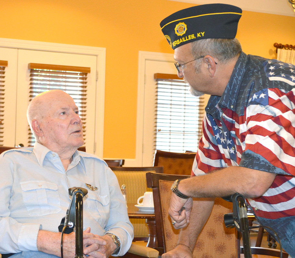 ARMY AIR CORPS VETERAN John Lucas talked to American Legion Post 67 member Brian Wolff, right, before a special program honoring five veterans, including Lucas, who reside at Daisy Hill Senior Living Community in Versailles. (Photo by Bob Vlach)
