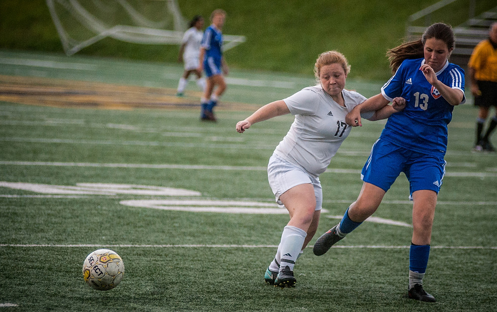 TIFFANY ROYSTER battles Frankfort defender Claire Irish in the second half of their game played Wednesday, Sept. 6, at Community Stadium. (Photo by Bill Caine)